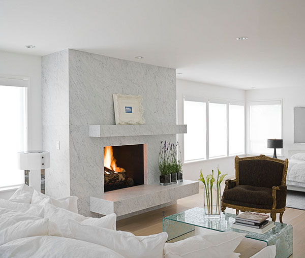 home, residential, bedroom, white marble fireplace, white, mantle, brown antique chair, Turner Helton Antiques, white Gervasoni sofa with pillows, green glass Rialto Deco by Fiam table, modern