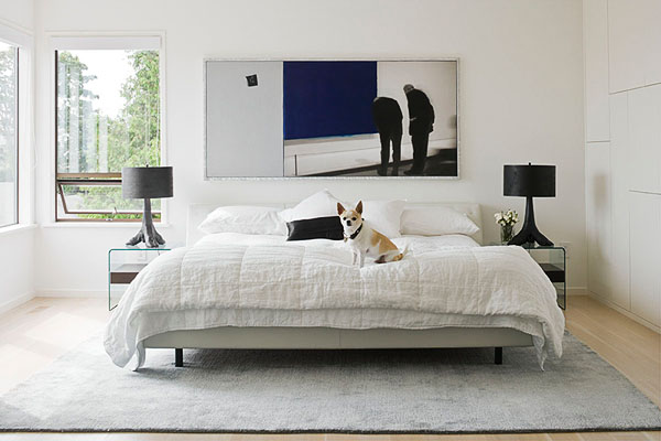 home, residential, bedroom, white leather wrapped bed, dog, Isa D'Arleans painting, black faux hoofed lamps, modern, Simply White Benjamin Moore Paint