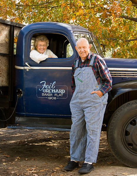 Man, Woman, couple, retired, senior, blue truck, orchard, fall