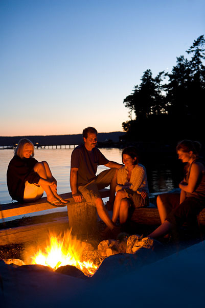 Beach, Fire, Fire Pit, logs, dusk, twilight, man, woman, children, family, girls