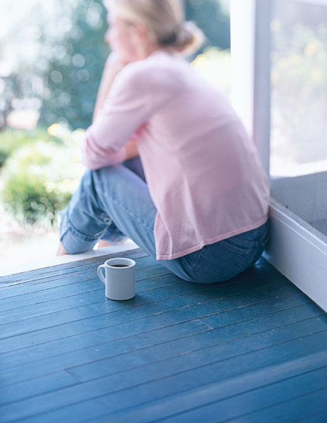 woman, porch, pink sweater, coffee, sitting, steps, screen door, jeans