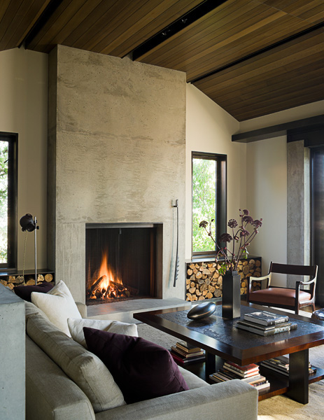 home, residential, concrete, living room, mahogony window, frames, gray couch, purple pillow, fireplace, cut wood bins, architectural photographers, interior photographers