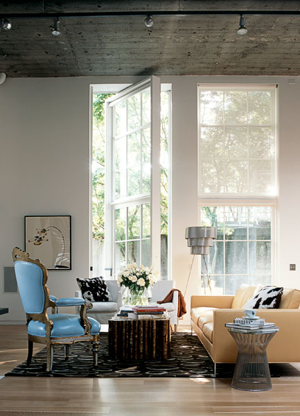 home, residential, living room, wood floor, white, rotating floor to ceiling windows and doors, blue chair, yellow couch, architectural photographers, interior photographers, seattle